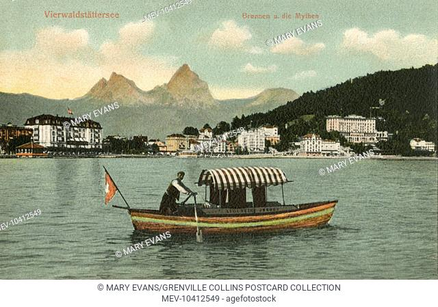 Small tourist rowing boat on Lake Lucerne (German - Vierwaldstattersee - 'Lake of the Four Forested Cantons') is a lake in central Switzerland