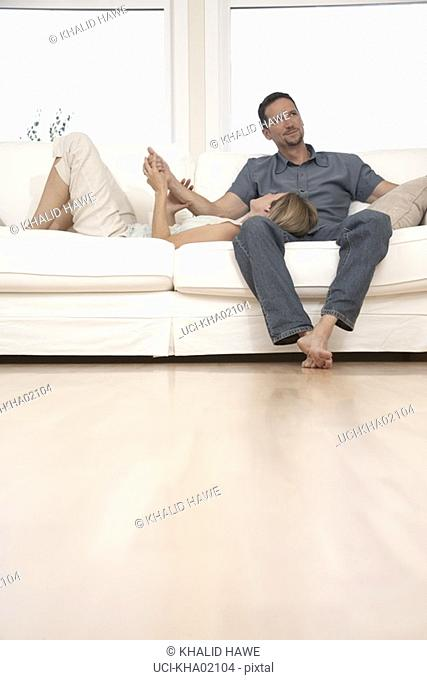 Young couple relaxing on couch