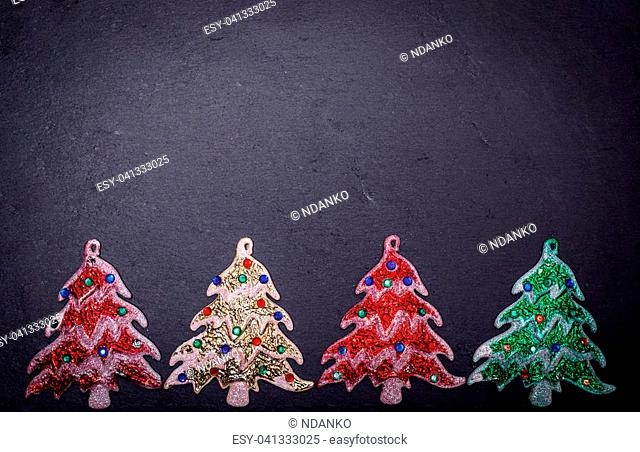 abstract black background with New Year decoration in the form of a Christmas tree, empty space in the middle