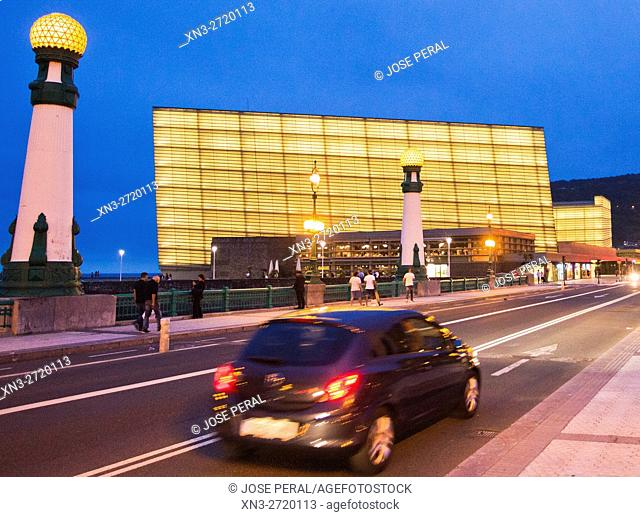 On background Kursaal Palace by the architect Rafael Moneo, Zurriola Bridge with streetlights Art Deco over river Urumea, Donostia, San Sebastian, Gipuzkoa
