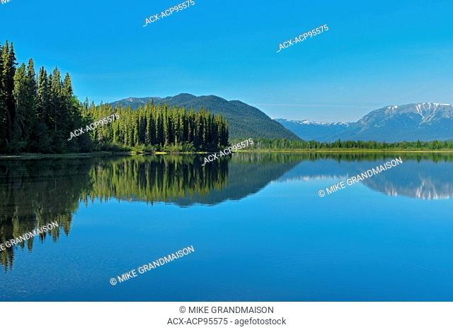 Coast Mountains reflected in Tattoga Lake near Iskut along the Stewart Cassiar Highway British Columbia Canada