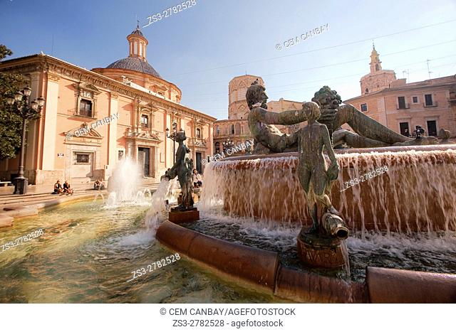 Turia fountain with the Virgen de los Desamparados Basilica and Santa Maria de Valencia Cathedral on the back Plaza de la Virgen- Virgin Square in the old town
