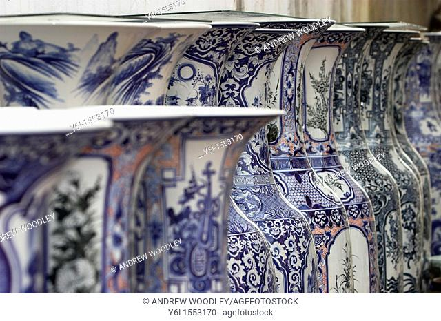 Long line display of Oriental design vases outside shop ceramic village Bat Trang near Hanoi Vietnam