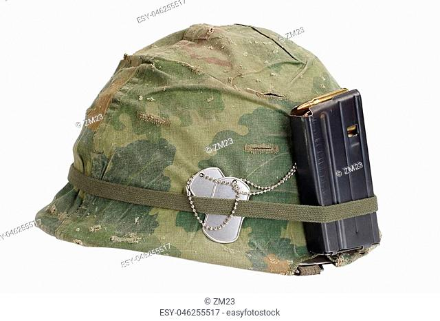US Army helmet Vietnam war period with camouflage cover, magazine with ammot and dog tags isolated on white