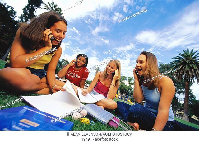 Teenage girls on cell phones