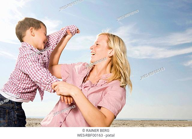 Germany, Schleswig Holstein, Amrum, Mother and son 3-4 on the beach