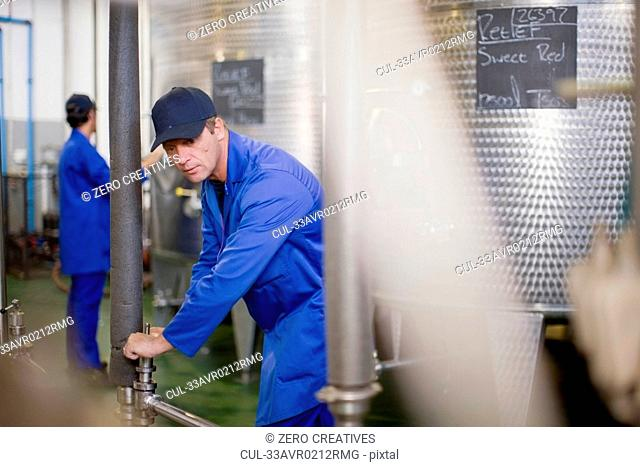 Worker releasing valve in factory