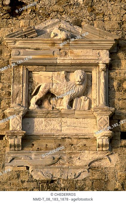Close-up of a lion's statue carved on a wall, Crete, Greece