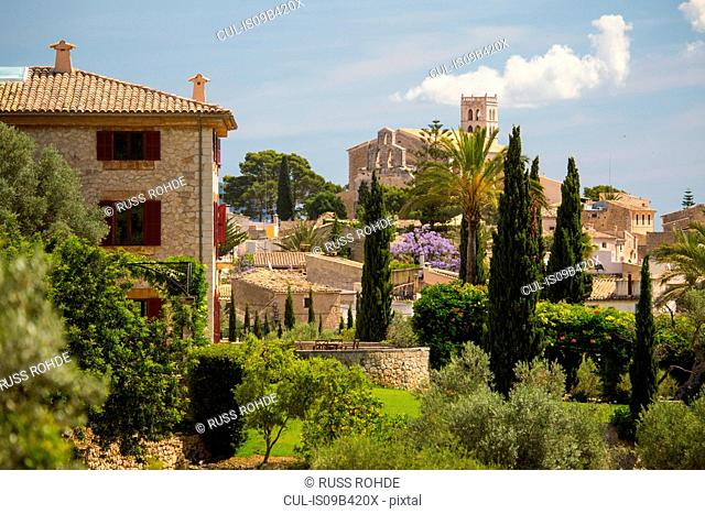 Elevated view of church tower and village, Selva, Majorca, Spain