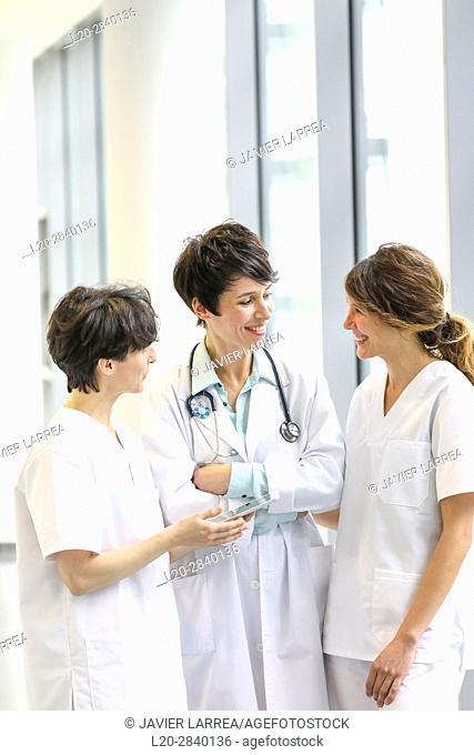 Doctors and nurses talking in corridor, Hospital, Donostia, San Sebastian, Gipuzkoa, Basque Country, Spain