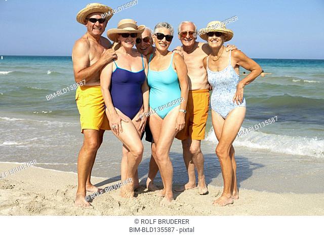 Senior friends smiling on beach