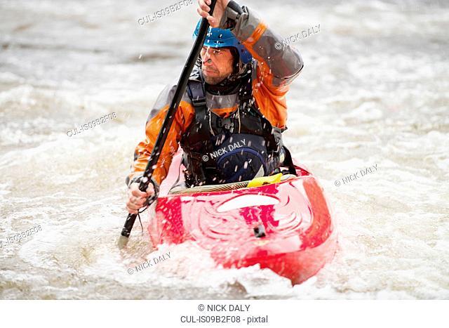 Male kayaker paddling River Dee rapids