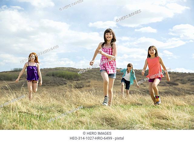 Little girls running during field trip