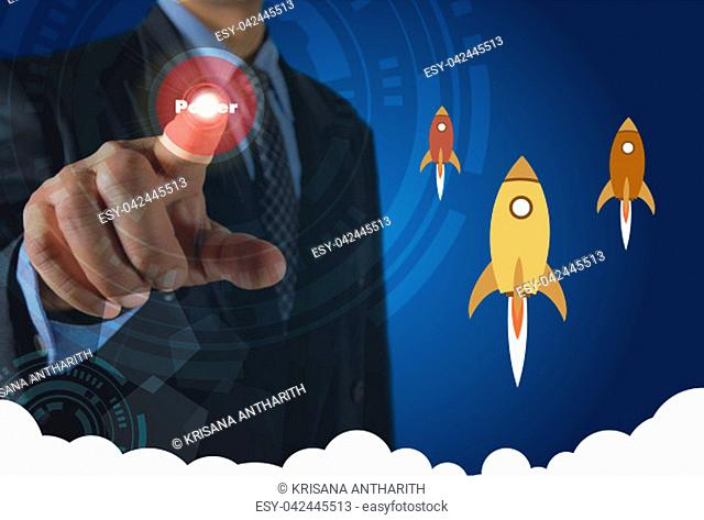 Businessman pressing virtual buttons on screen concept with rocket and white cloudy