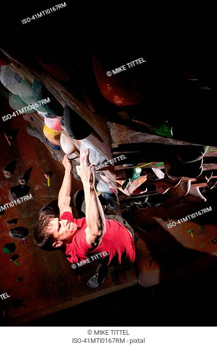 Man climbing indoor rock wall