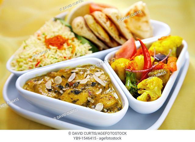 Indian set lunch meal  Sag mushroom korma and vegetable balti