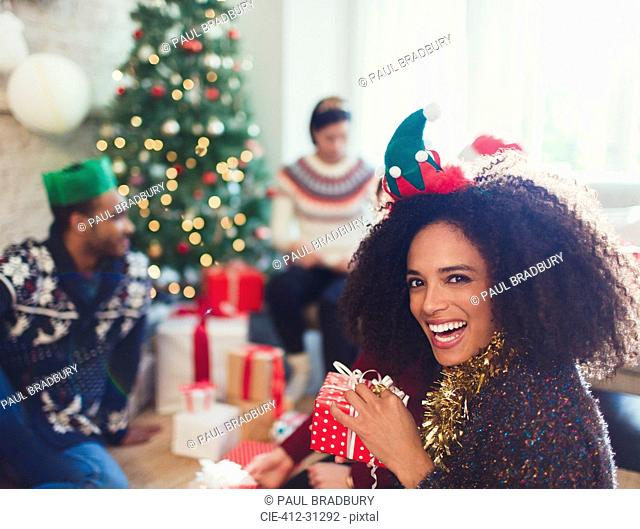 Portrait enthusiastic woman holding Christmas gift