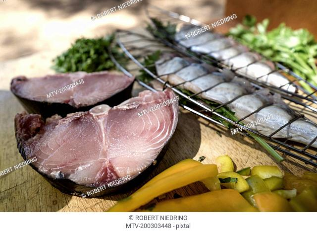 Close-up of tuna fish with bell pepper and mackerel on chopping board, Puglia, Italy