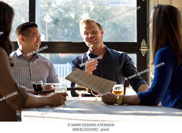 Friends talking at table in brew pub