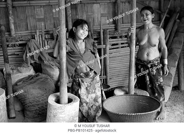 Murang mother and daughter are working at their home Bandarban, Bangladesh April 2009