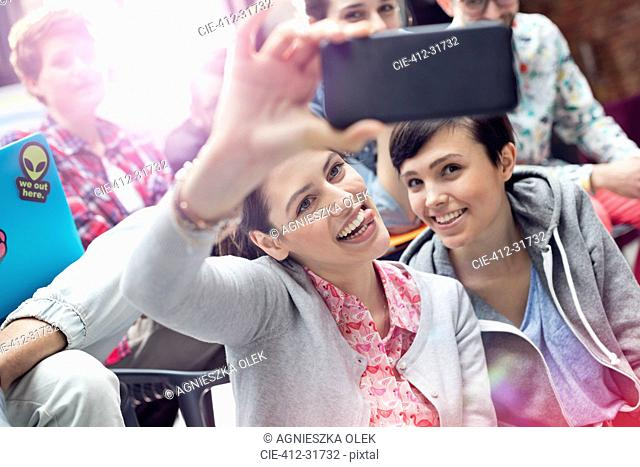 Playful female college students taking selfie