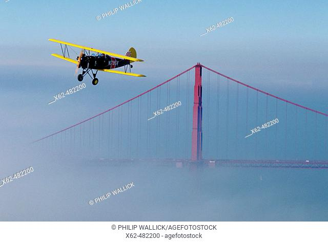 Biplan and Golden Gate bridge, San Francisco, California, USA