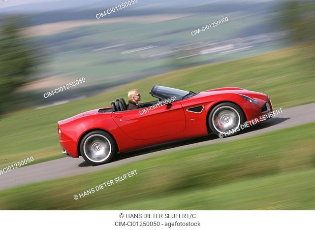 Alfa Romeo 8C Spider, model year 2006-, red, driving, side view, country road, open top