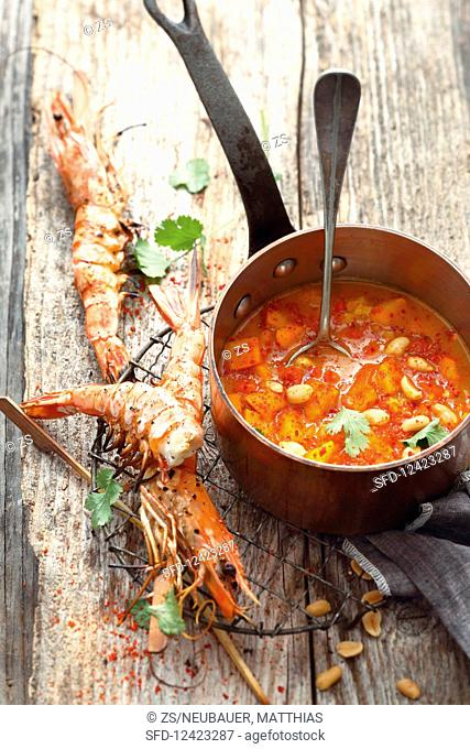 Pumpkin soup with grilled king prawns