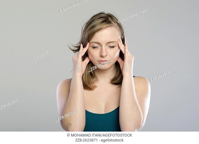Young woman massaging her temples