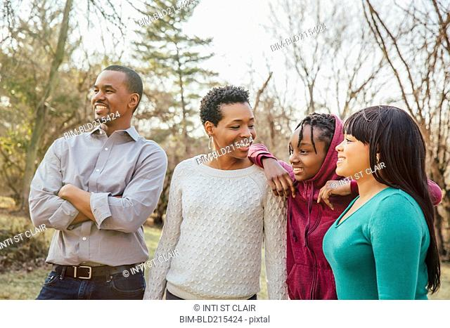 Black family smiling outdoors