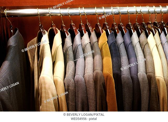 Men's sports jackets on a rack in a department store