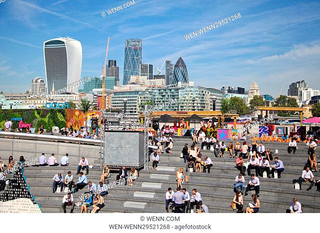 London Riverside, UK 13 Sept 2016 - With the Met Office forecasting temperatures of 30C, city workers and tourists enjoy the lunchtime sunshine in and around...