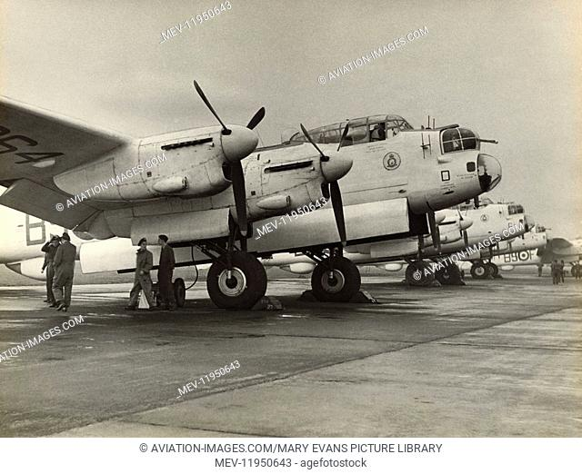 A Row of 120 Squadron Royal Air Force RAF Coastal Command Avro 683 Lancaster ASR-3S Parked with Bomb-Doors Open and Ground Crew