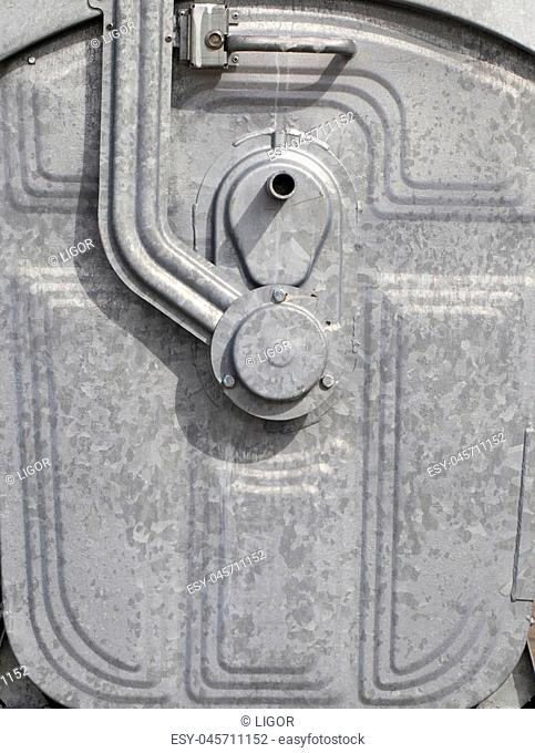 photo of a metal garbage container. Close-up of the tank cover fixing mechanism