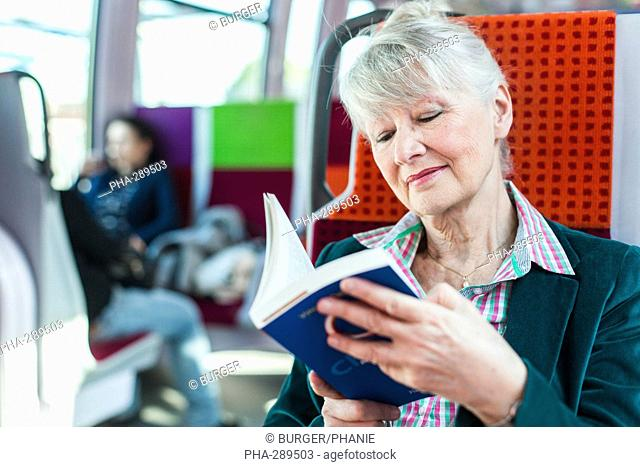Senior woman in a train