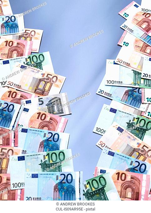 Euro currency notes split into two piles
