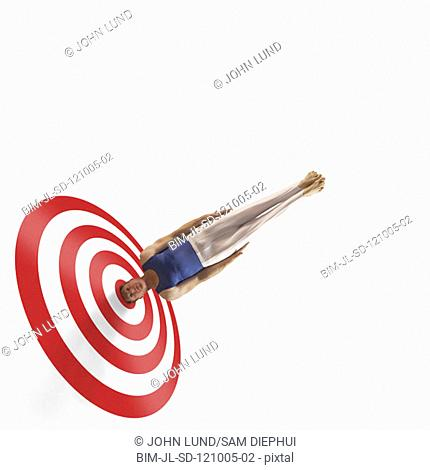 Gymnast's head in the bullseye of a target