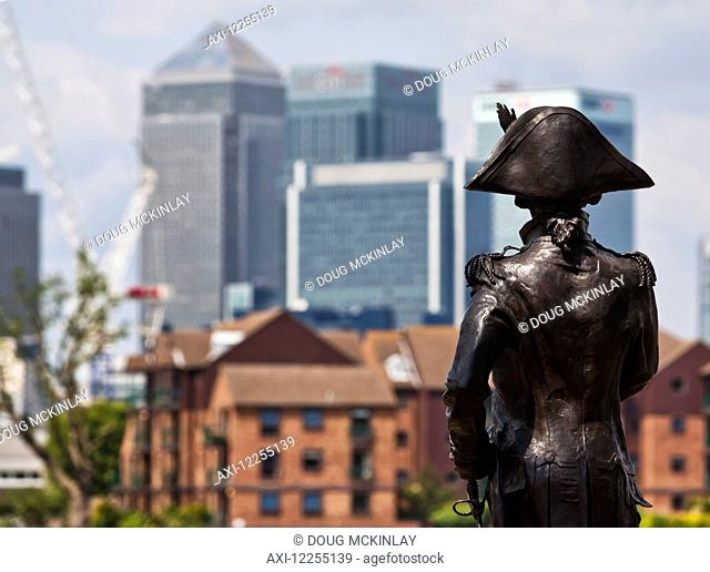 Sculpture of Admiral Lord Nelson in Greenwich with the buildings of Canary Wharf in the background; London, England