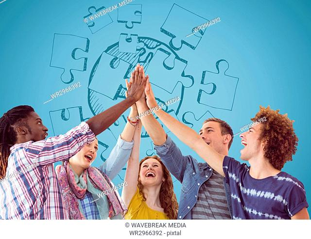 Trendy team putting hands together against blue jigsaw doodle and blue background