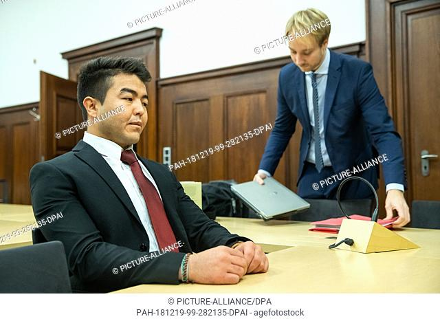 19 December 2018, Bavaria, Nürnberg: Asif N. (r), a refugee from Afghanistan, sits next to his lawyer Michael Brenner in the courtroom of the Nuremberg District...