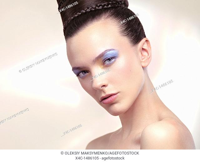 Beauty portrait of a young woman with soft pastel color makeup and beautiful hairstyle