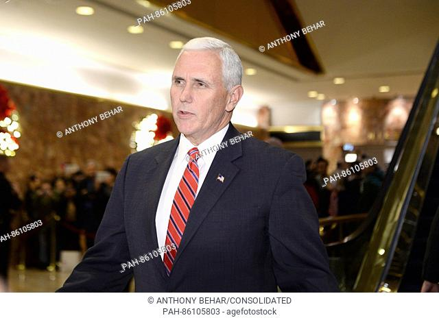 United States Vice President-elect Mike Pence is seen leaving Trump Tower in New York, New York, on November 28, 2016. Credit: Anthony Behar / Pool via CNP - NO...