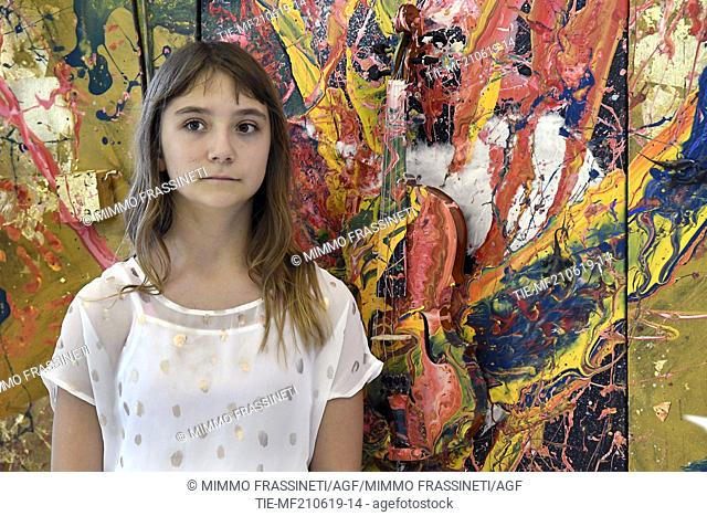 Aelita Andre, Australian young painter (12 years old ) tells herself at the Museum of Civiltà in Rome ,ITALY-20-06-2019
