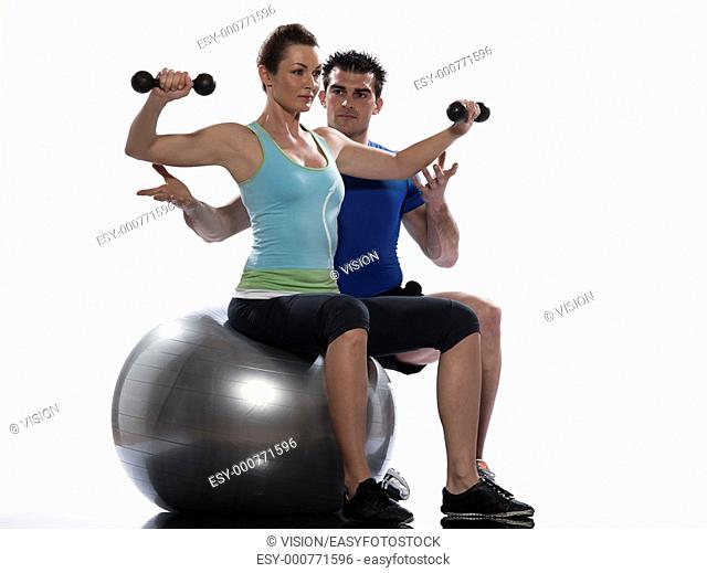 couple, man and woman exercising workout on white background  Seated Swiss Ball Lateral Arm Raise
