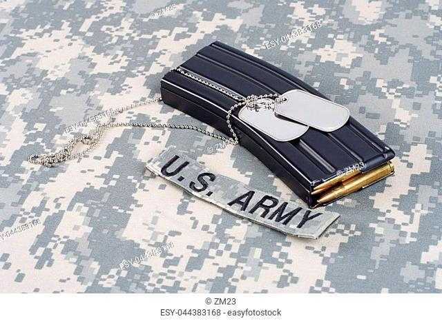 M-16 magazine with ammo on camouflage US Army uniform