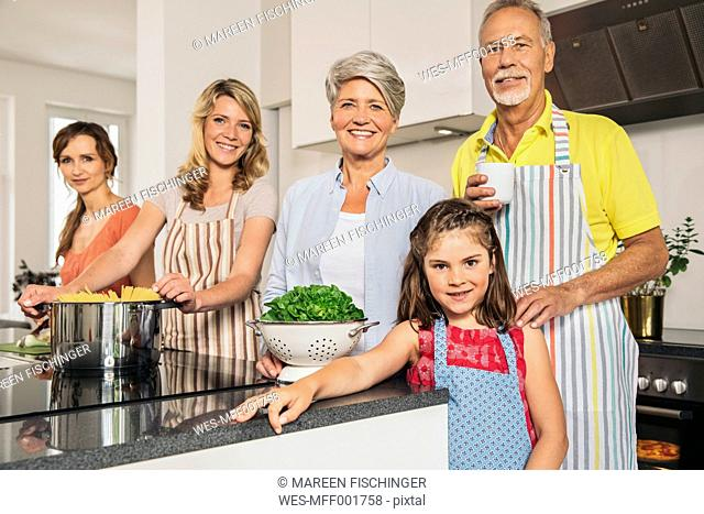 Portrait of extended family in the kitchen