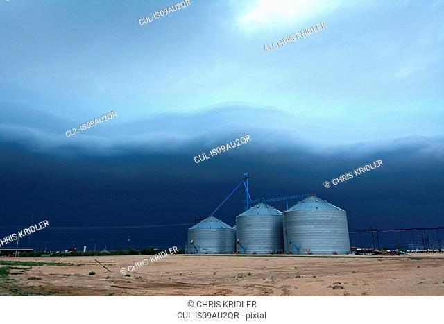 Arcus cloud from storm over grain silos, Dalhart, Texas, USA