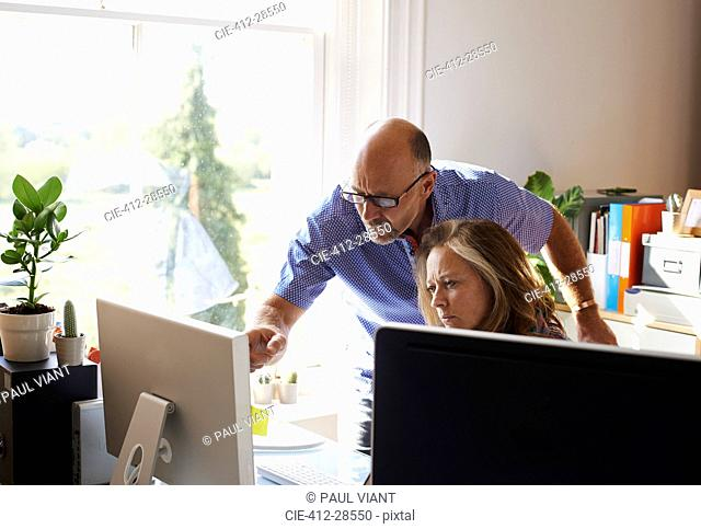 Business people working at computer in home office