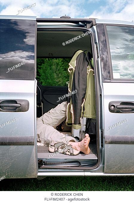 Exhausted Man Sleeping in a Van