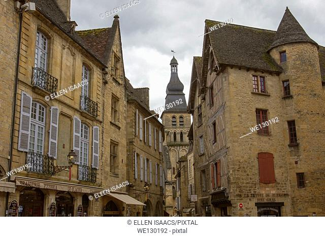 Beautiful medieval sandstone buildings and bell tower of Saint-Sacerdos Cathedral in charming Sarlat, Dordogne region of France